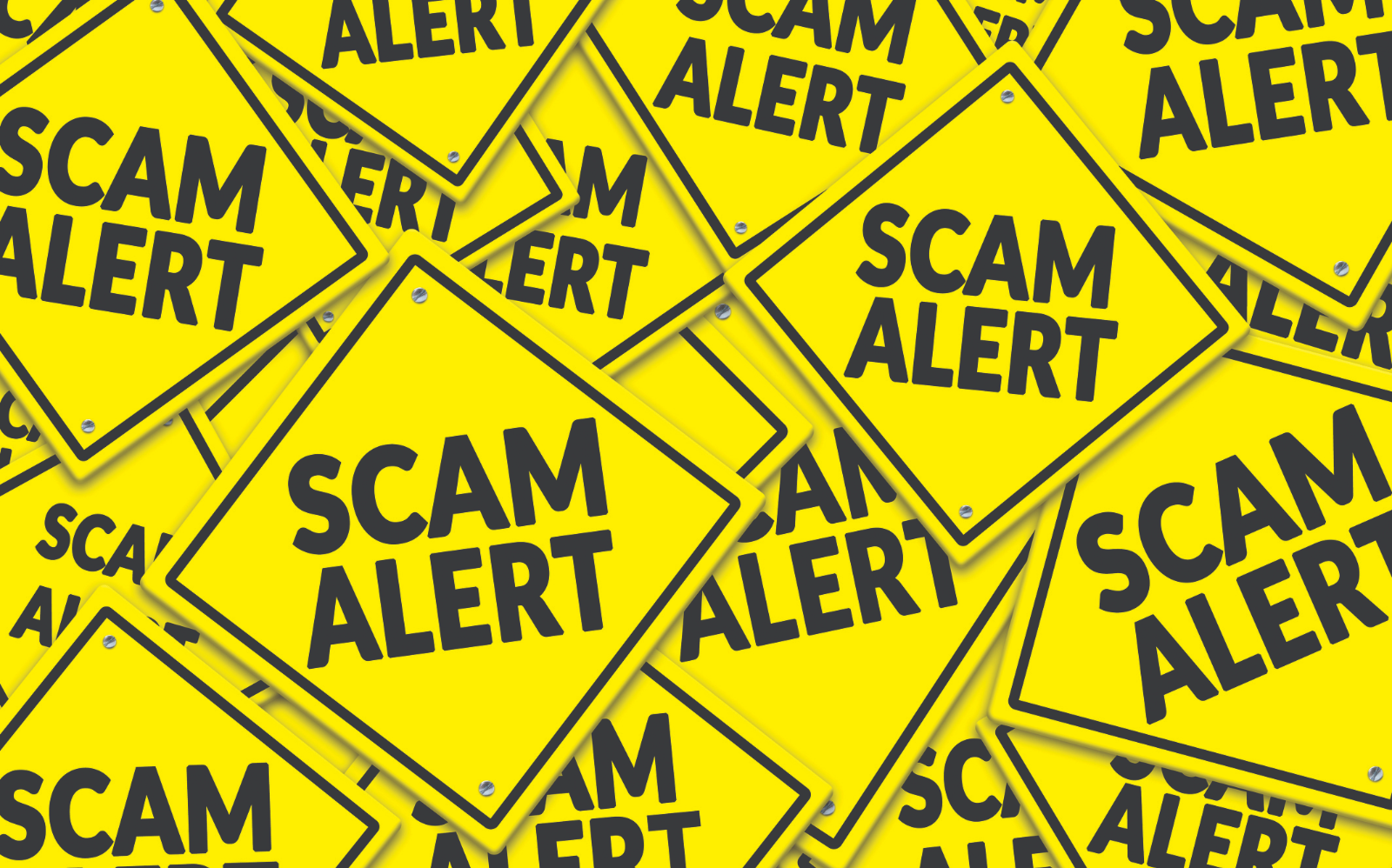 signs saying Scam Alert